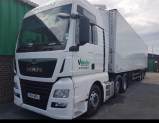 Velocity Transport Solution's White MAN artic tractor unit featuring the logo on the passenger door