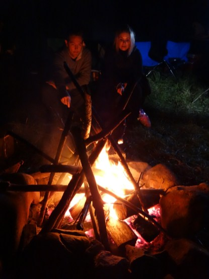 Wendy and hubby Bevan, toasting marshmallows on the fire.