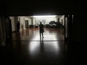 The team investigates part of the ballroom