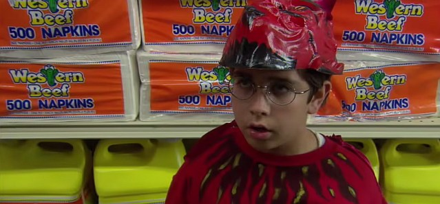 A still image taken from the film Satan's Little Helper, showing a young boy wearing a devil costume.