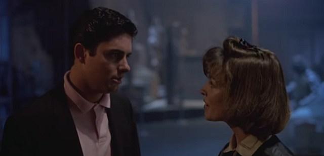 A still taken from the movie Waxwork (1988), showing Zach Galligan talking to Deborah Foreman.