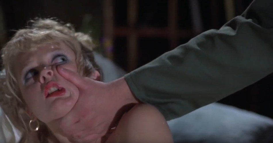 A screenshot from the 1981 horror film Final Exam. It shows a man grabbing a young woman by the face.