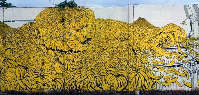 Wandgemälde des Künstlers BLU - Menschen aus Bananen