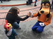 MomMom high-fiving Goofy