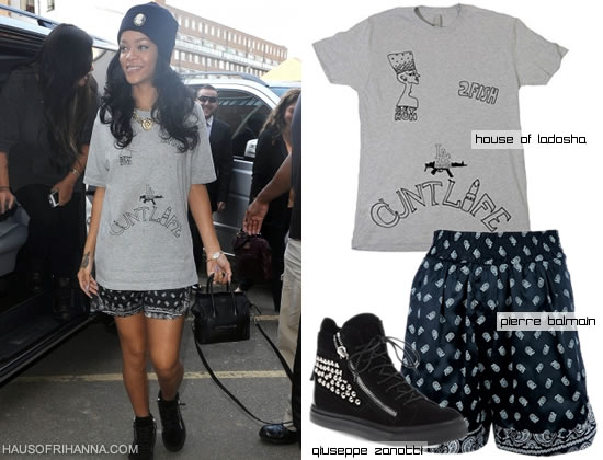Rihanna in House of Ladosha 2pac t-shirt, Melody Ehsani Queen of the Jungle necklace, Giuseppe Zanotti studded sneakers, Pierre Balmain shorts, Silver Spoon Attire beanie