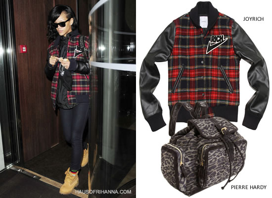 Rihanna in Joyrich plaid Freshman Varsity jacket in red/black, Pierre Hardy leopard print backpack, Timberland boots and Ray-Ban Wayfarer sunglasses