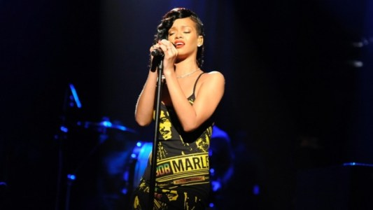 Rihanna on Saturday Night Live wearing Adam Selman Bob Marley dress