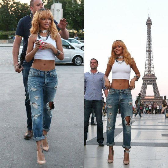 Rihanna in Acne distressed jeans, Manolo Blahnik suede BB pumps, American Apparel white cropped top