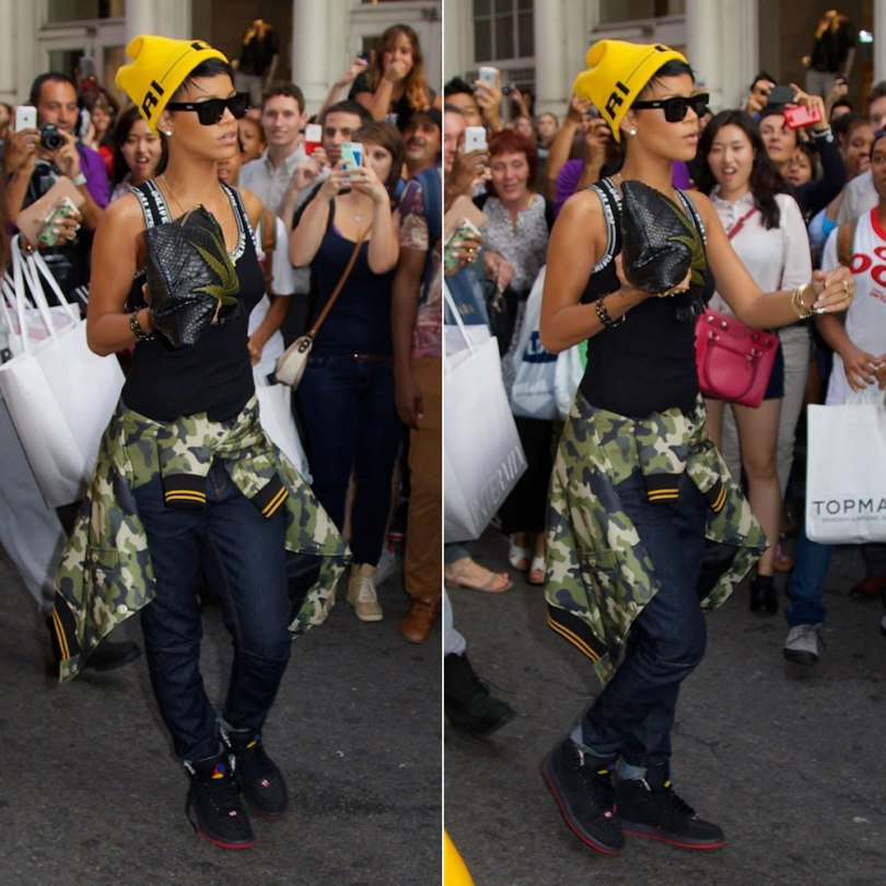 Rihanna shopping in New York wearing Rihanan for River Island beanie, vest, jeans and camouflage bomber jacket