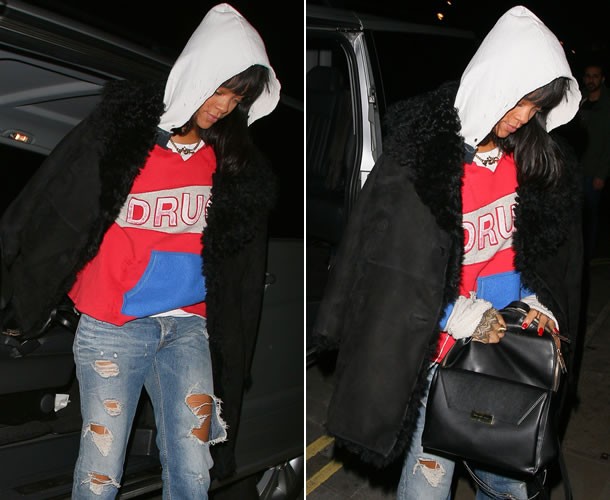 Rihanna wearing Raif Adelberg Deadboys Clubhouse Drugs hoodie, Acne Generic Girl ripped jeans, Azzedine Alaia black shearling coat, Stella McCartney faux leather backpack