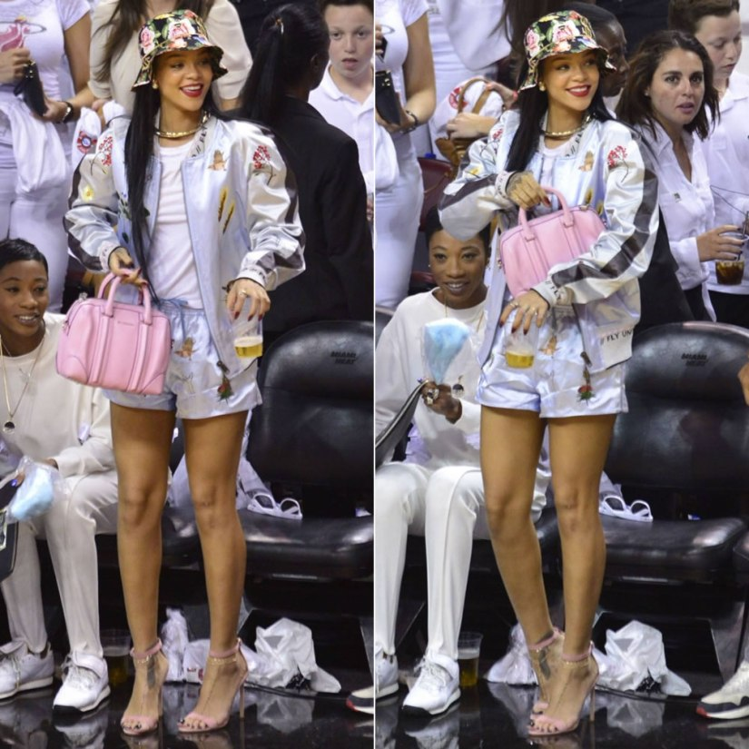 Rihanna at Miami Heat basketball game wearing Joyrich bucket hat and Bernhard Willhelm bomber jacket and shorts with Manolo Blahnik Chaos sandals