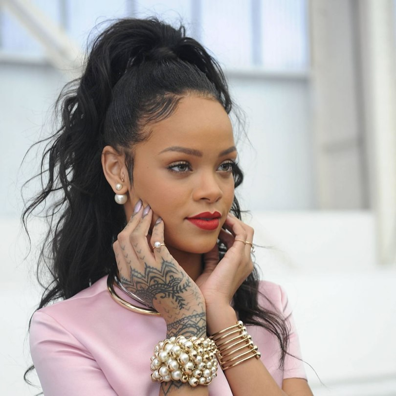 Rihanna wearing Mise en Dior and Diorific pearl jewelry at the Dior Resort 2015 fashion show