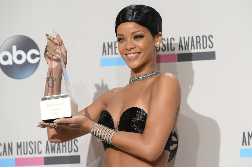 Rihanna holding her Icon Award at the 2013 American Music Awards