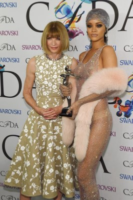 Rihanna posing with Anna Wintour in the press room at the CFDA Awards
