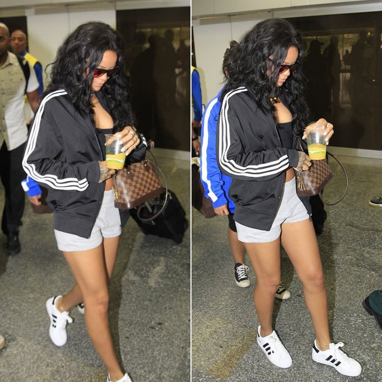 Rihanna in Brazil wearing Adidas black track jacket, grey shorts, Superstar 2.0 sneakers
