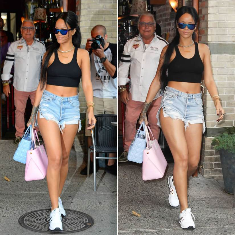 Rihanna wearing 3.1 Phillip Lim mirrored sunglasses, Levi's vintage cutoff grommet shorts, New Balance 574 white sneakers, Dior blue Lady Dior and pink Dior Addict handbag, Lynn Ban chevron ring, Fallon emerald cut silhouette ring