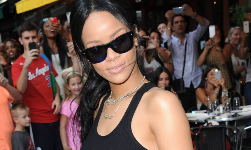 Rihanna wearing 3.1 Phillip Lim blue mirrored sunglasses, Mala by Patty Rodriguez Where you from necklace