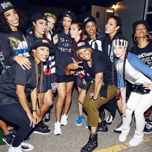 Rihanna backstage at The Monster Tour wearing Pigalle black snapback cap, Shady vs Everybody black hoodie, New Balance 574 white sneakers