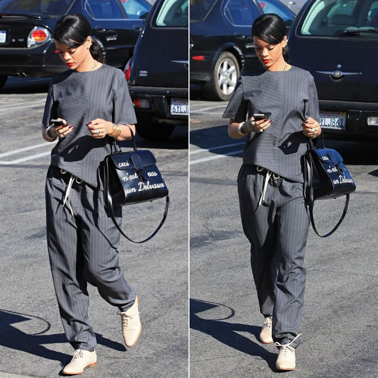 Rihanna wearing Alexander Wang pinstripe top, pinstripe pants, Ingrid almond croc oxford shoes, Delvaux Ceci n'est pas un Delvaux handbag, Yvonne Leon pearl earrings, Monster Tour iPhone 5 case