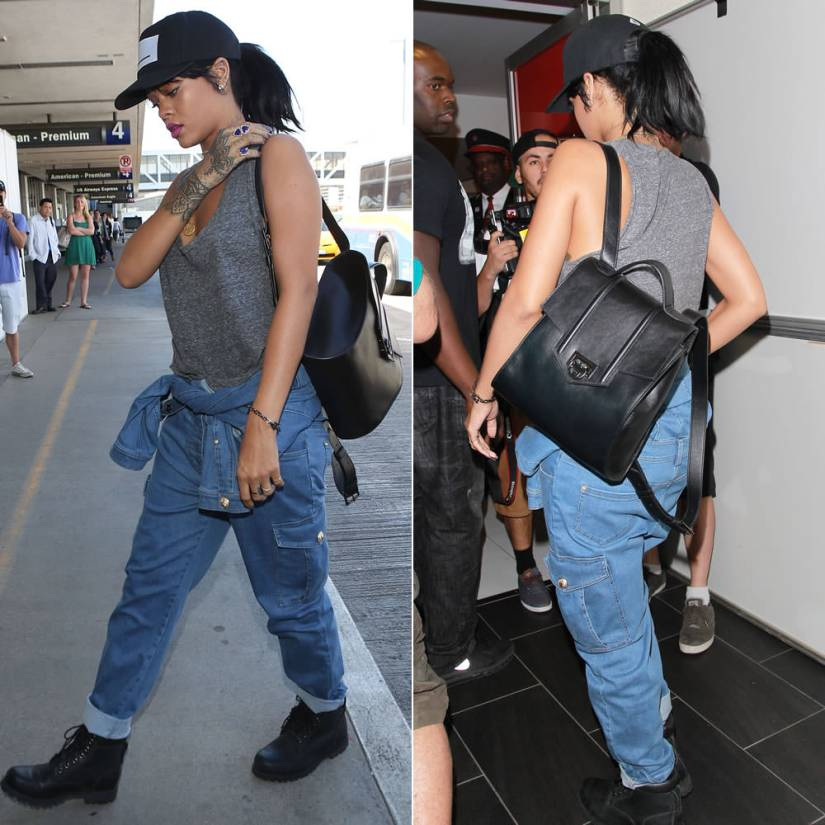 Rihanna wearing Balmain Spring/Summer 2014 denim jumpsuit, Pigalle black snapback cap, Reece Hudson Siren black backpack, Campise rose gold gun necklace, Jacquie Aiche double teardrop lapis ring and lapis trinity ring