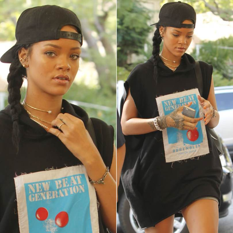 Rihanna wearing Givenchy black baseball cap, Martine Rose Fall 2014 black sleeveless hoodie, Inez and Vinoodh pearl necklace, Nektar de Stagni pearl choker, Jennifer Fisher ID bracelet, Reece Hudson Siren backpack