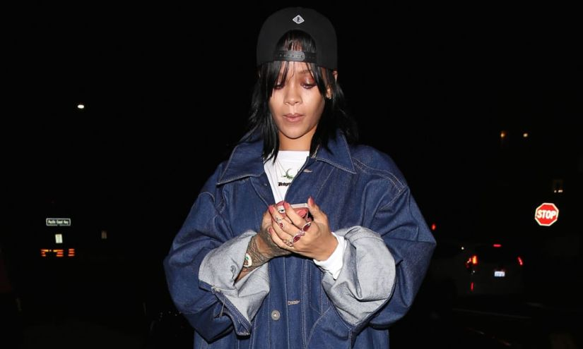 Rihanna wearing Pigalle snapback cap, Jacquie Aiche emerald crescent necklace, trinity ring, double teardrop ring, knuckle ring, Sabine G Navano Prospero ring