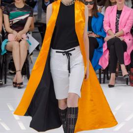Christian Dior Spring 2015 yellow coat, black top and white shorts as seen on Rihanna