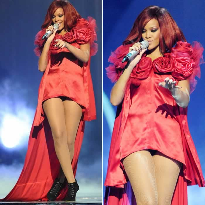 Rihanna performing at the 2011 Brit Awards in a custom Giles Deacon red dress