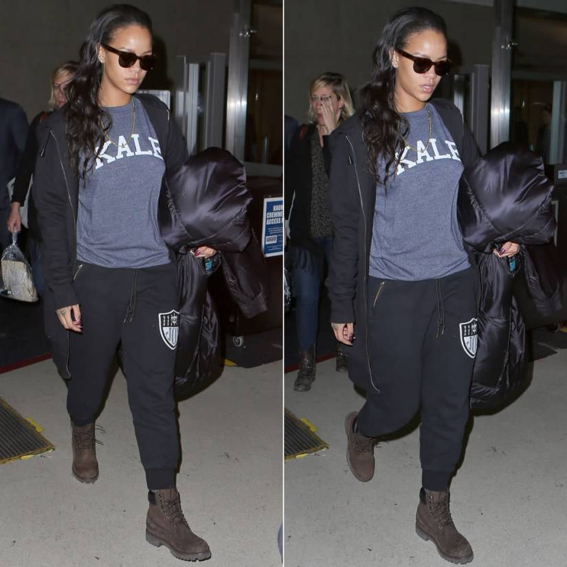 Rihanna wearing Trapstar elongated hoodie, Sub_Urban Riot Kale sweatshirt, Joyrich Rich Team sweatspants, Timberland chocolate boots