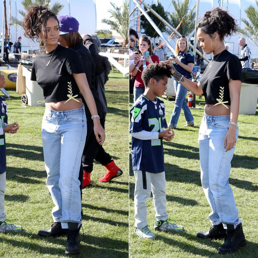 Rihanna wearing Toga Archives bow side lace-up cropped t-shirt, Timberland Earthkeepers boots in Black Roughcut, Jacquie Aiche hoop earrings