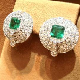 David Webb white diamond and emerald earrings as seen on Rihanna
