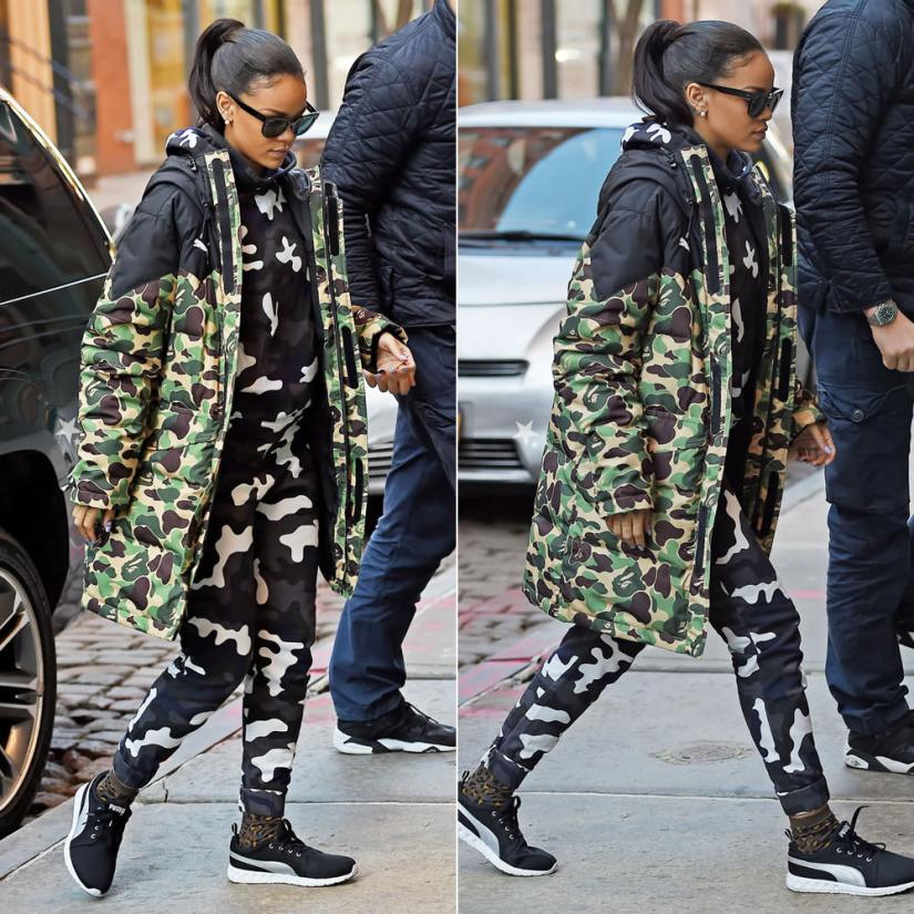 Rihanna wearing Puma x A Bathing Ape camouflage jacket, Christopher Kane camouflage sweatpants and sweatshirt, Puma Carson running shoes, Stance Street Cat leopard print socks, Zanzan Avida Dollars sunglasses
