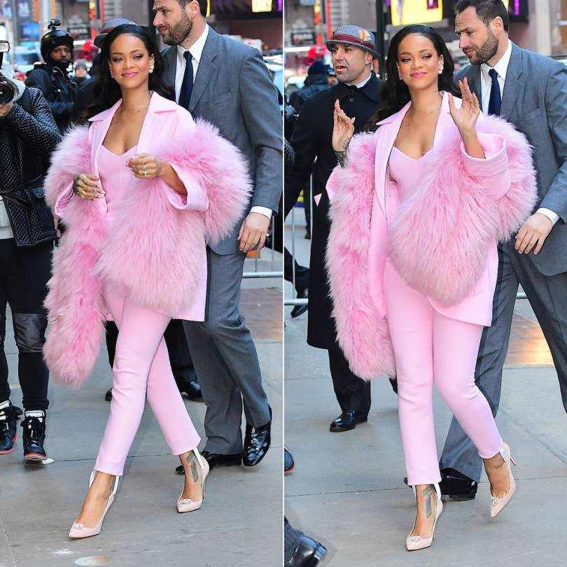 Rihanna wearing Pascal Millet Fall 2015 pink coat, stirrup jumpsuit and boa, Dior Mise en Dior tribal earrings and Christian Louboutin for Holly Fulton Fall 2015 pumps on Good Morning America