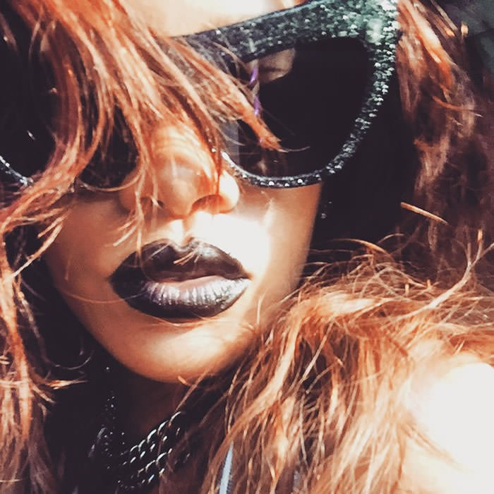 Rihanna wearing Adam Selman x Le Specs Playgirl black glitter cat eye sunglasses, Free Spirits Cosmetics Thug Life lipstick