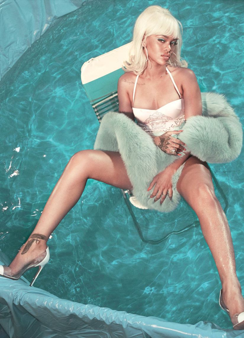 Rihanna in V magazine summer 2015 issue wearing an Alexandre Vauthier fur stole, Versace one-piece swimsuit and Manolo Blahnik Pacha leather pvc pumps