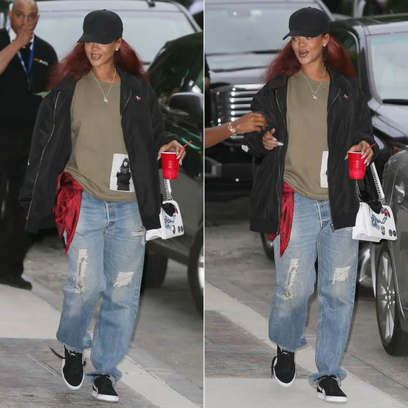 Rihanna wearing Sam MC London big logo jacket, Drkshdw by Rick Owens middle finger nun patch sweatshirt, Puma Suede Classic black sneakers, Christian Dior Diorama white quilted and embroidered handbag, Lynn Ban two-headed serpent necklace
