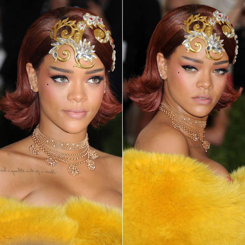 Rihanna at 2015 Costume Institute Met Gala in Guo Pei headpiece, Cartier gold necklace