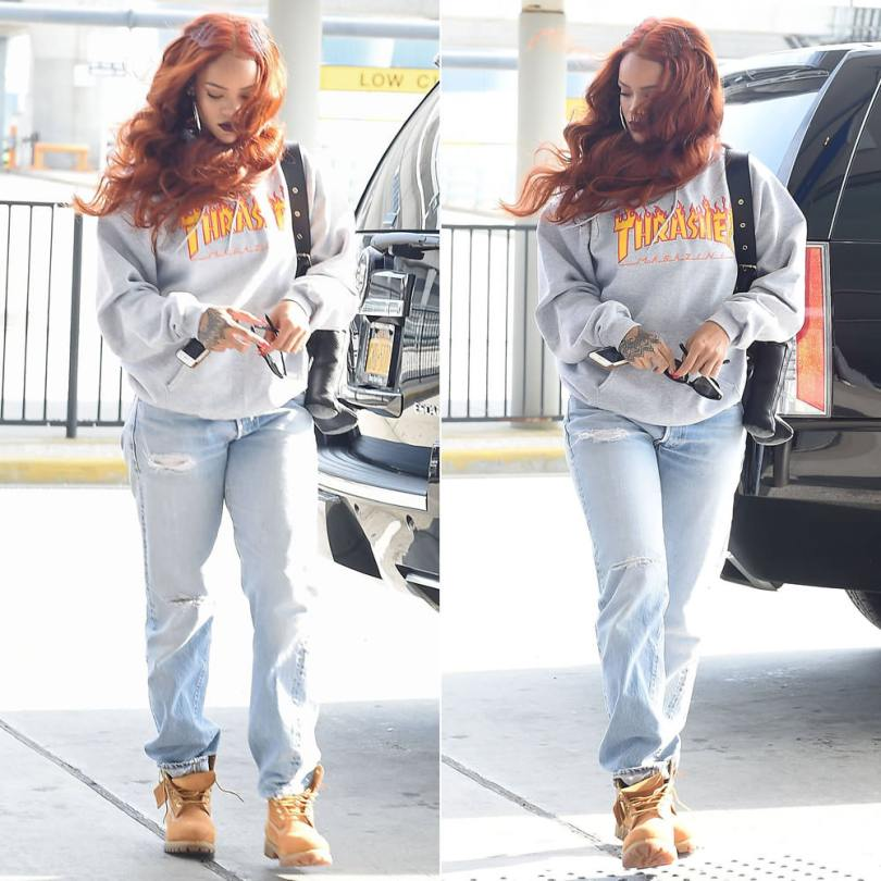 Rihanna wearing Thrasher flame logo hoodie, Timberland wheat boots, Dominic Louis x Mandy Coon leather bunny backpack