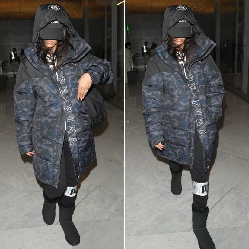Rihanna Puma BAPE dark camo coat Paris, Puma Icon sweatpants, 40oz Van studios cap, Ugg Bailey Button black boots