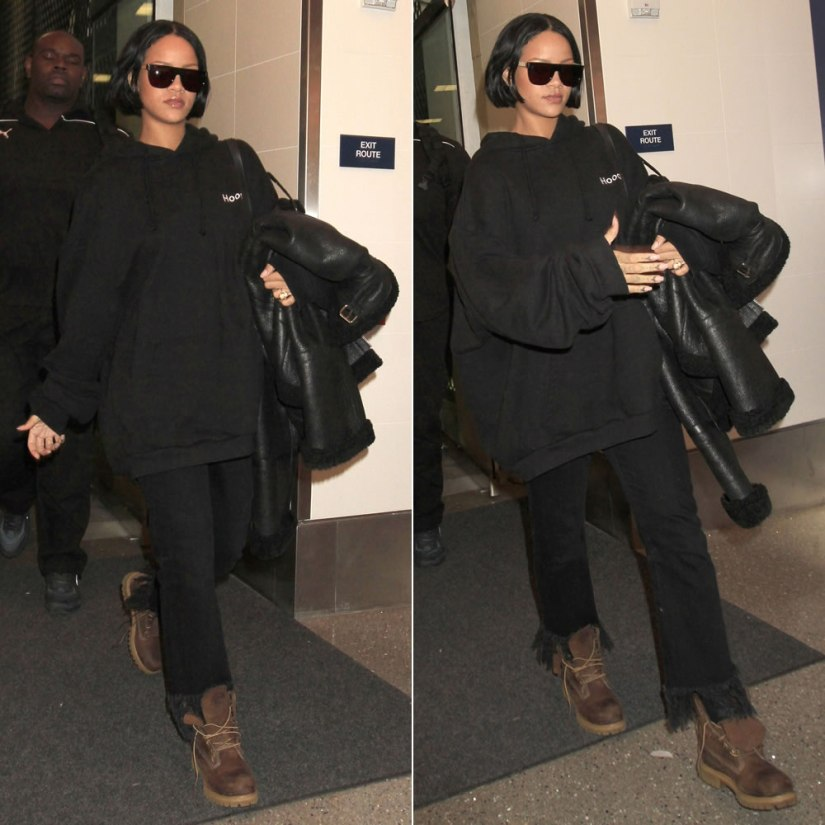 Rihanna Vetements black hoodie, Vetements shearling leather jacket, Timberland brown Heritage boots, 3x1 WM3 fringe jeans, Super Francis sciuro gold flat top sunglasses