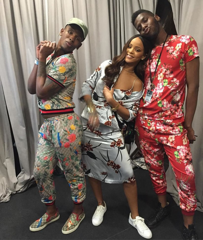 Rihanna Ganni Sanders floral print quilted jacket and satin slip dress, Puma Basket Classic sneakers, Moschino Fall 2016 gold logo cuff, Versace Palazzo sequin backpack