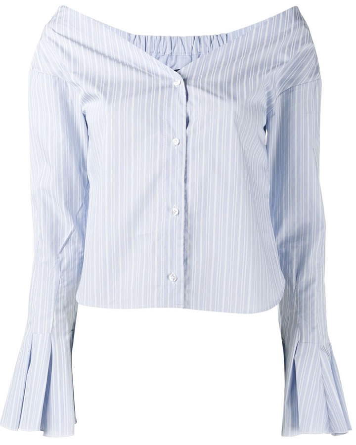 592796827c8 The trendsetting singer rocked a blue and white striped top by Jacquemus.  The poplin top is an off-the-shoulder design with a v neckline