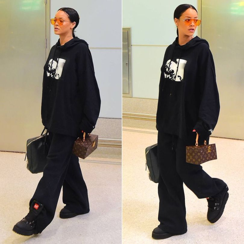 Rihanna Fenty Puma rubberized boots, graphic hoodie, triple waistband sweatpants, Gentle Monster x Opening Ceremony Zhora Ori sunglasses, Prada Saffiano padlock briefcase, Louis Vuitton Twisted Box handbag