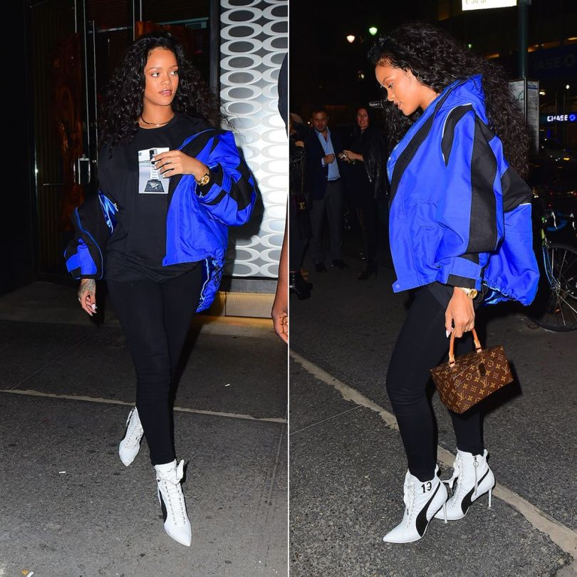 Rihanna Balenciaga blue off shoulder parka jacket, Roc Nation Clearport t-shirt, Fenty x Puma white high heel sneaker boot, Louis Vuitton Twisted Box handbag