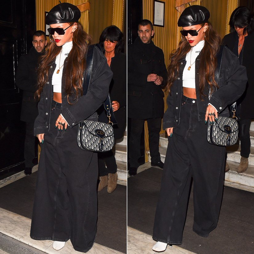 Rihanna Balenciaga wide leg jeans and black denim jacket, Off-White c/o Virgil Abloh long-sleeve cropped top, Vetements white sock boots, Dior handbag and Fall 2017 beret