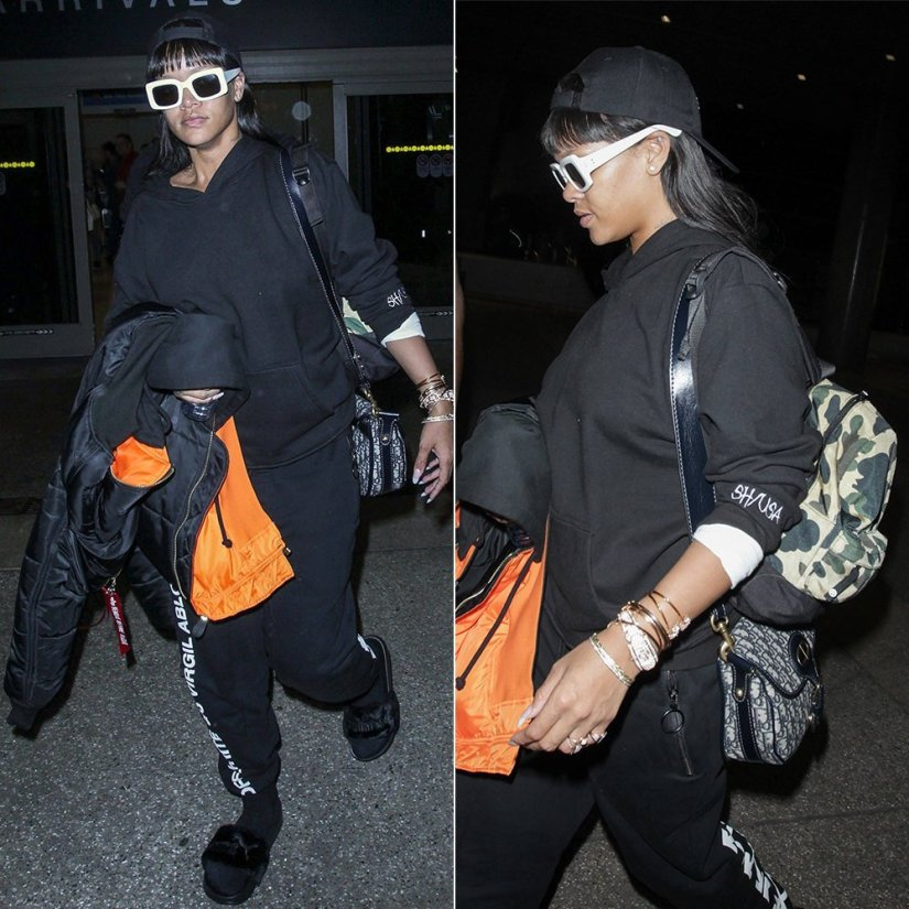 Rihanna Shadow Hill black ghost hoodie, Off-White black sweatpants, Vetements x Alpha Industries black reversible bomber jacket, Fenty x Puma fur slides, BAPE 1st camo cordura backpack, Raen flatscreen sunglasses, Bathory hat, Jacquie Aiche cameo ring and frame teardrop moonstone ring,