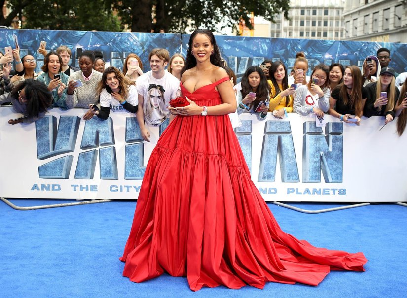 Rihanna Valerian London premiere Giambattista Valli red couture gown, Jimmy Choo red flower clutch, Chopard jewelry
