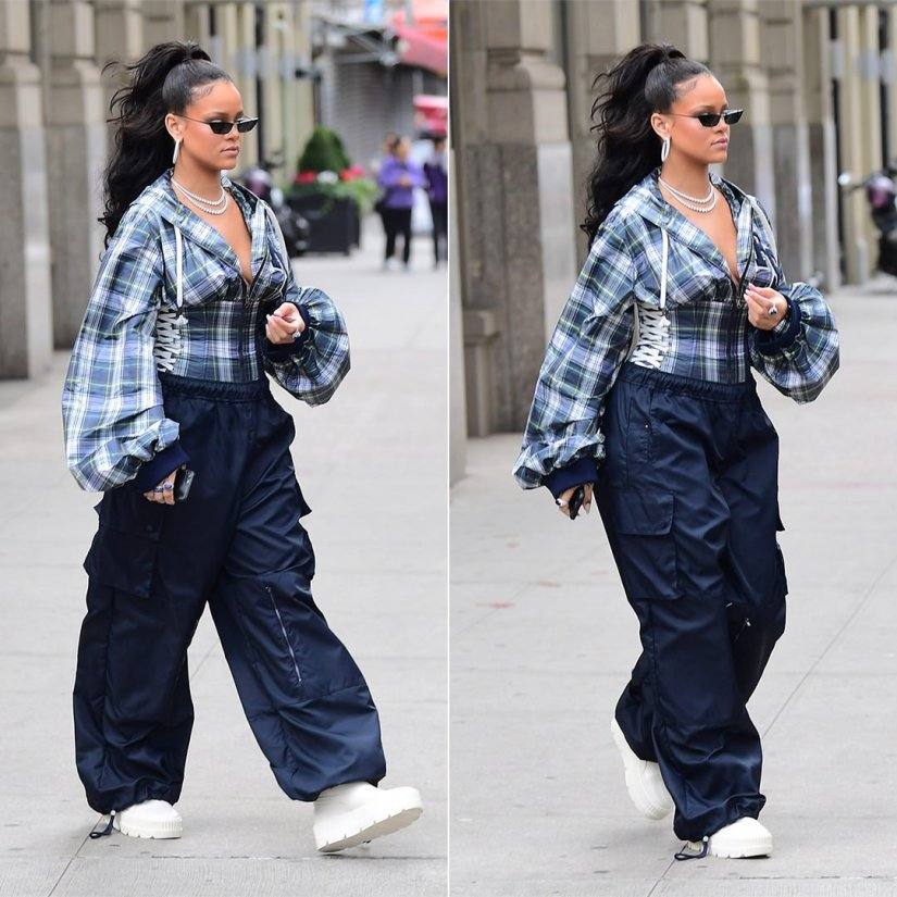Rihanna Fenty x Puma pep rally Fall 2017 plaid top, blue track pants, white boots, Prada Spring 2018 sunglasses, Butani diamond hoops