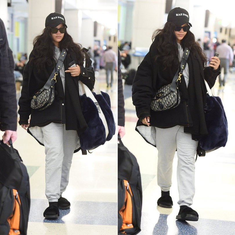 Rihanna Raf Simons denim jacket JFK airport, Bathory hat, Palace Skateboards grey hoodie and sweatpants, Fenty x Puma black fur slides and blue fur shopper tote, Dior oblique saddle bag