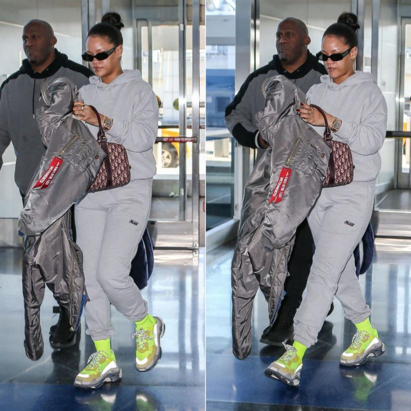 Rihanna Balenciaga yellow sneakers Triple S, Palace Skateboards grey Basically a hoodie and jogger, Vetements x Alpha Industries grey reversible bomber jacket, Dior vintage duffle bag, Patek Philippe Nautilus watch